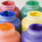 image of 6 botles of brightly colored paint
