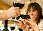 image of a woman holding a glass of wine and two other hands holding wine glasses