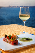 image of wine glass and plate of food